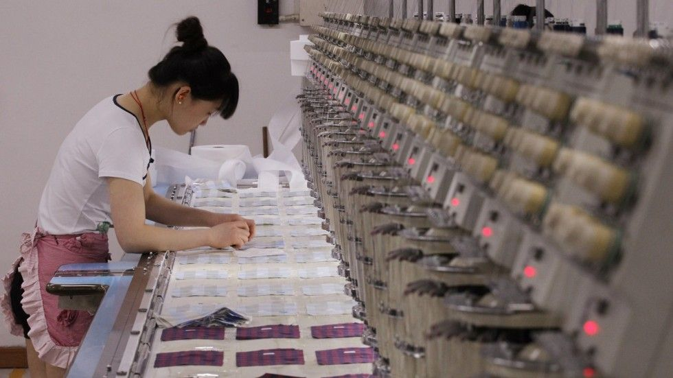 A woman operates an embroidering machine at the TAL factory in Dongguan. The company has invested heavily in new equipment to meet its buyers' demands and tough environmental regulations.   Many factories are trying to keep ahead of consumer changes are the rise and need for greener, more sustainable clothing production has been steadily increasing. (Jessie Roselyn, 9/17/17)