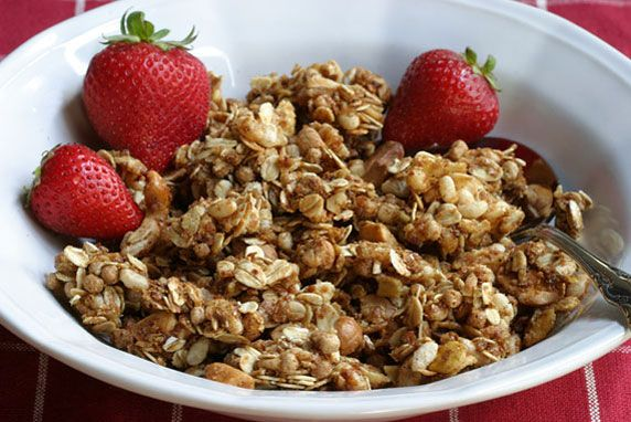 A healhty homemade granola recipe featuring oats, oat bran, wheat germ, puffed brown rice & cereal flakes, sweetened with honey, maple syrup & brown sugar.