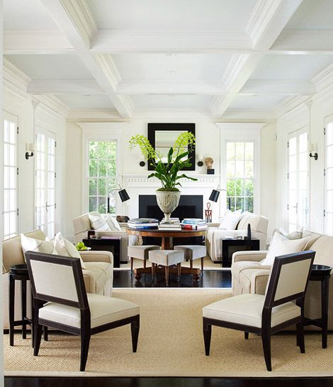 Nice layout with center table dividing the two seating - Multiple seating areas in living room ...