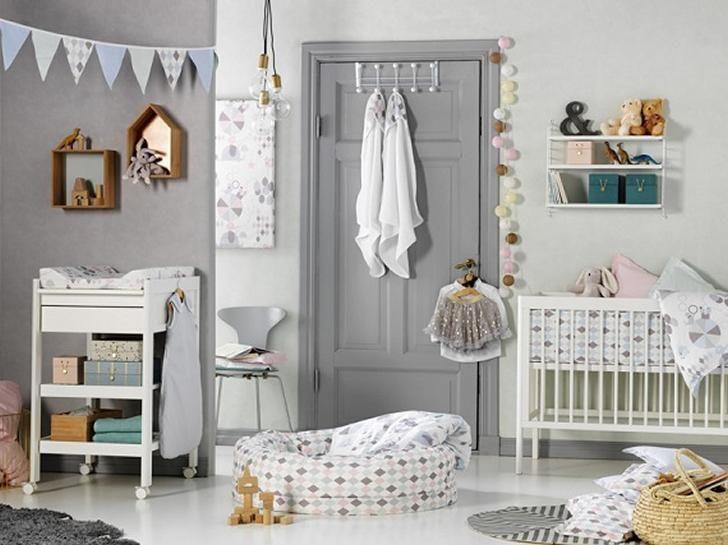Decorar con rombos arlequín la habitación del bebé Textil para