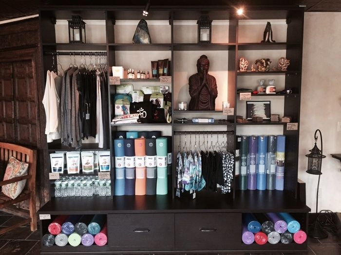 Yoga studio merchandise display california closets for Studio closet design