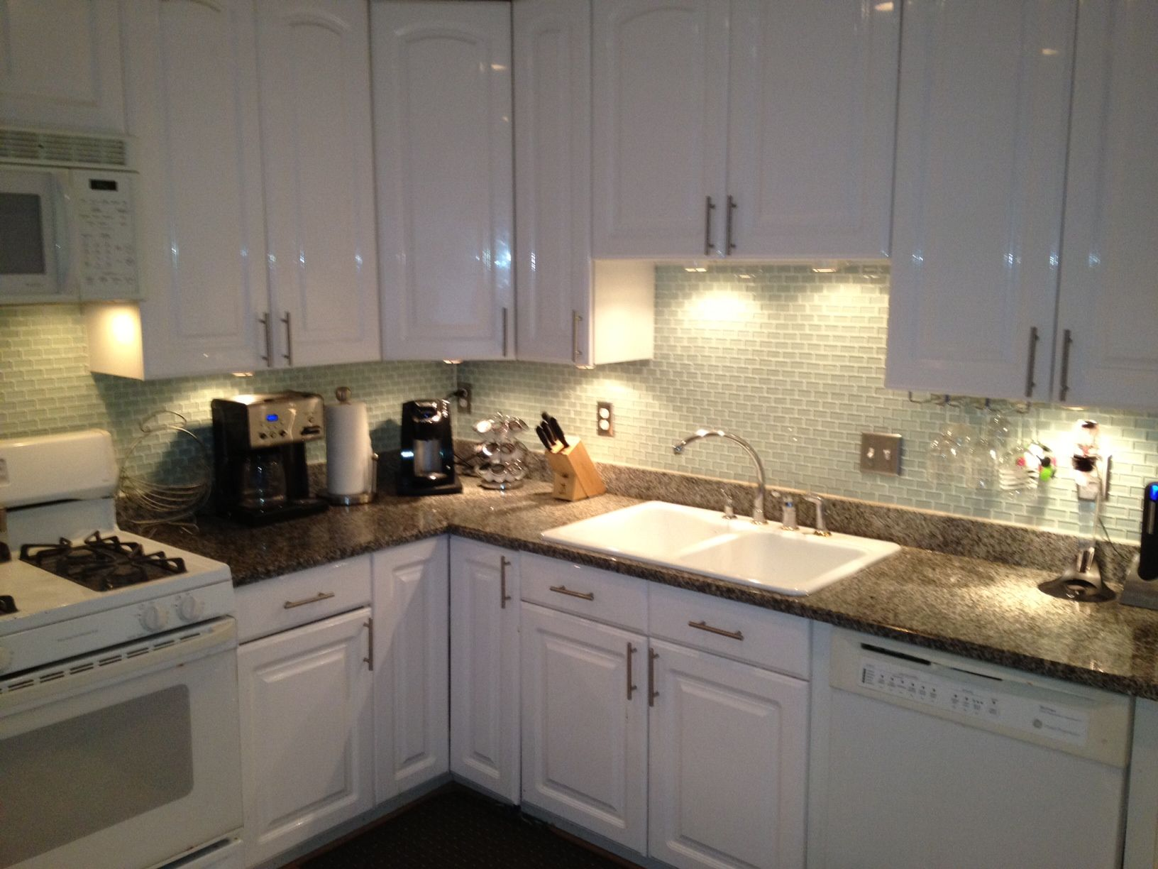Kitchen Backsplash Arctic Ice And Under Counter Lighting From Home Depot Goes Well With White Cabinets And G Home Home Interior Design Under Counter Lighting