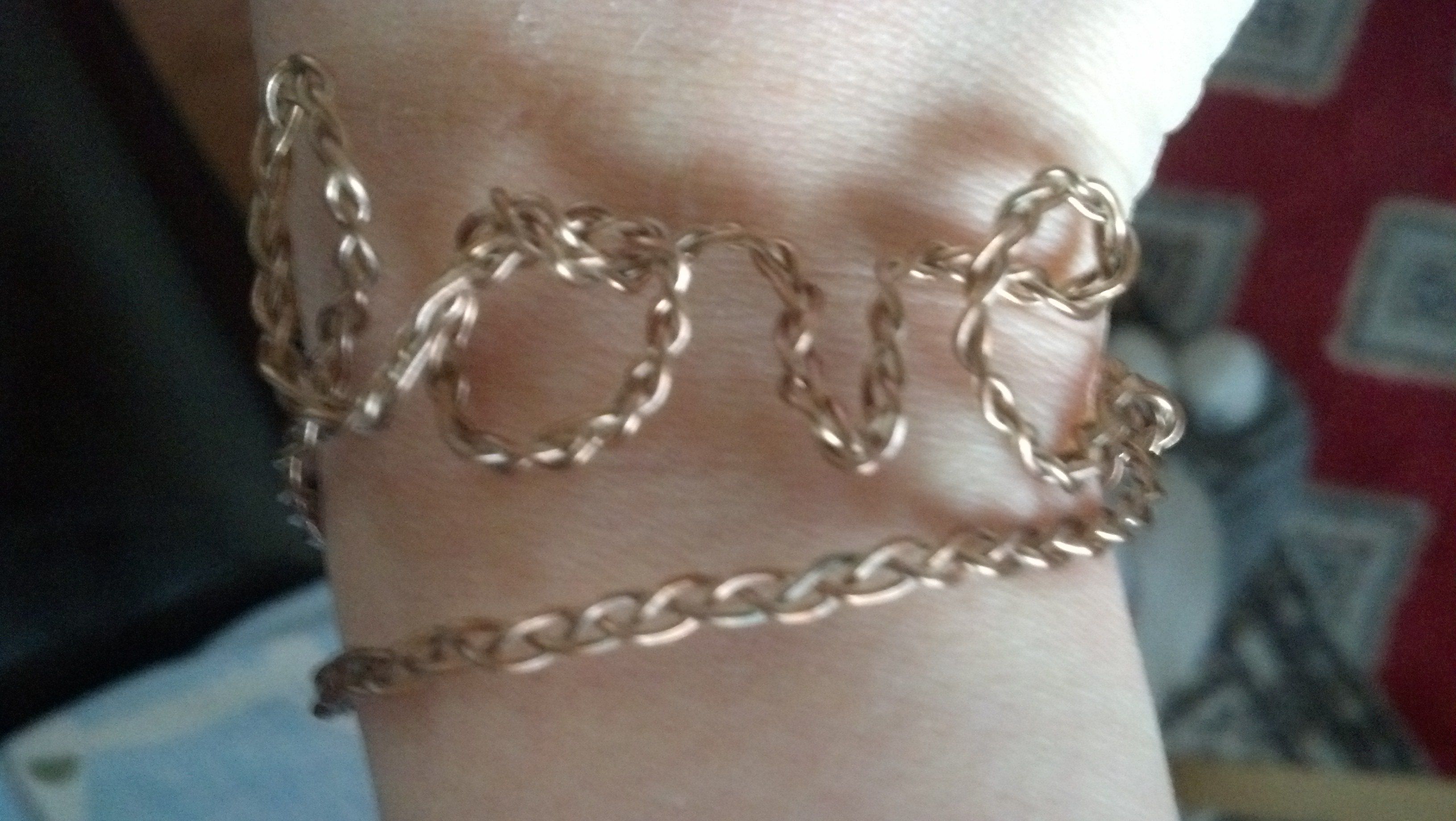 Easy DIY: Love Bracelet Braid wire, twist and bend into letters to spell love then pinch ends in