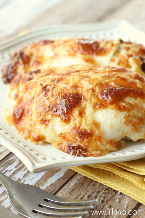Ingredients 4-6 Boneless Skinless Chicken Breast 6-8 Slices Swiss Cheese (Mozzarella works too) 1/2 cup mayonnaise 1/2 cup sour cream 3/4 cup grated Parmesan Cheese (divided) 1/2 tsp. salt 1/2 tsp. pepper 1 tsp. garlic powder Cooked Rice to serve over (optional)