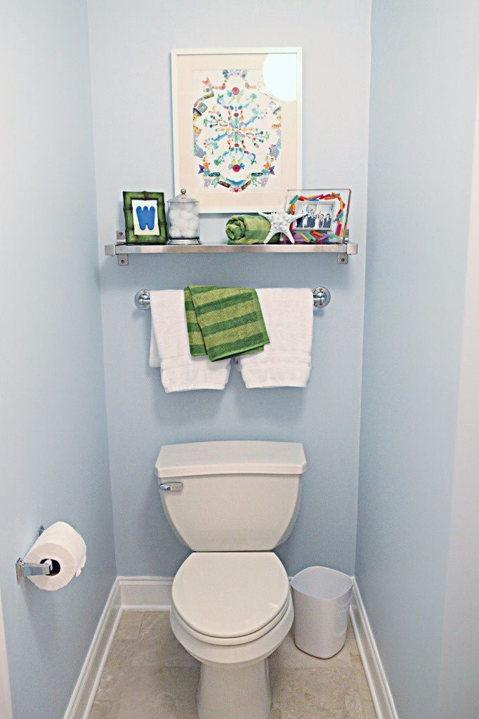 shelf, painting, and towel rack over toilet in master. | House ...