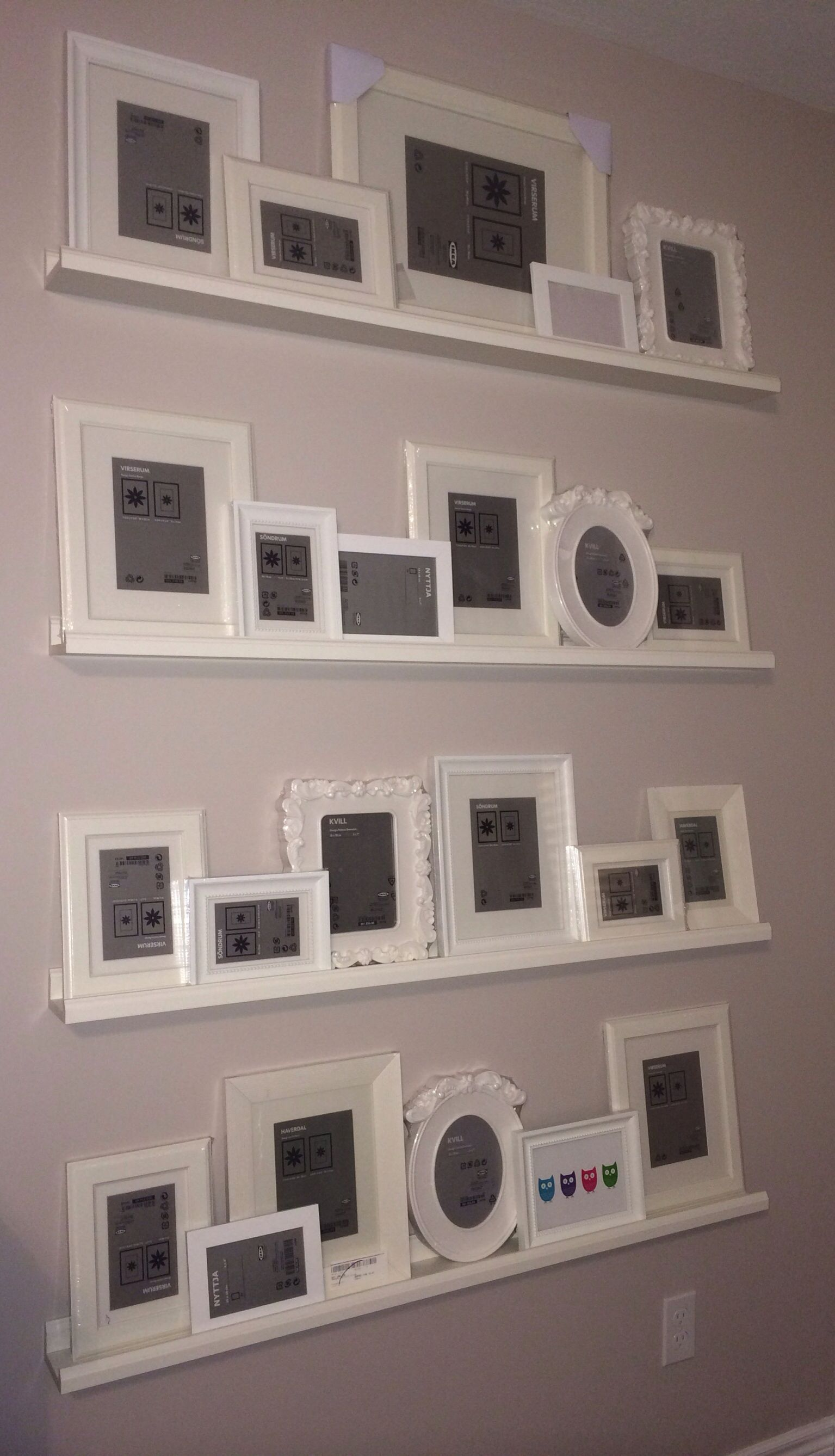 Gallery wall ikea picture ledges frames just need to for Gallery wall shelves