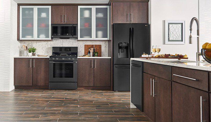 Top Kitchen Design Trends For 2019 What S In And What S Out Black Stainless Steel Appliances Beige Kitchen Matte Black Kitchen