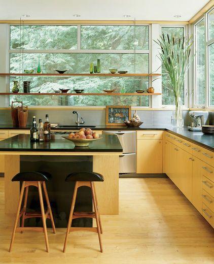 Shelves across expanse of windows.