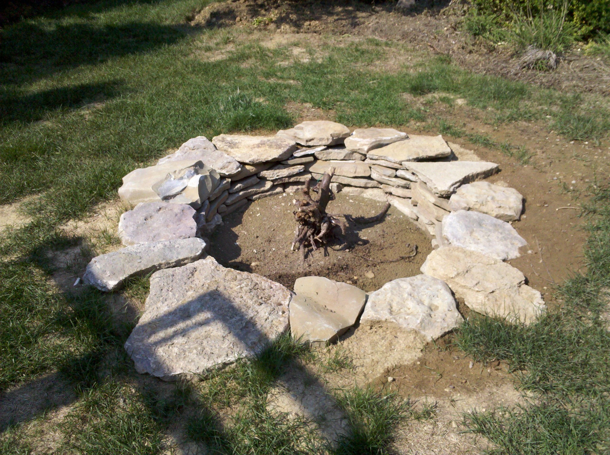 top layer of flagstone at groundlevel fire pit pinterest