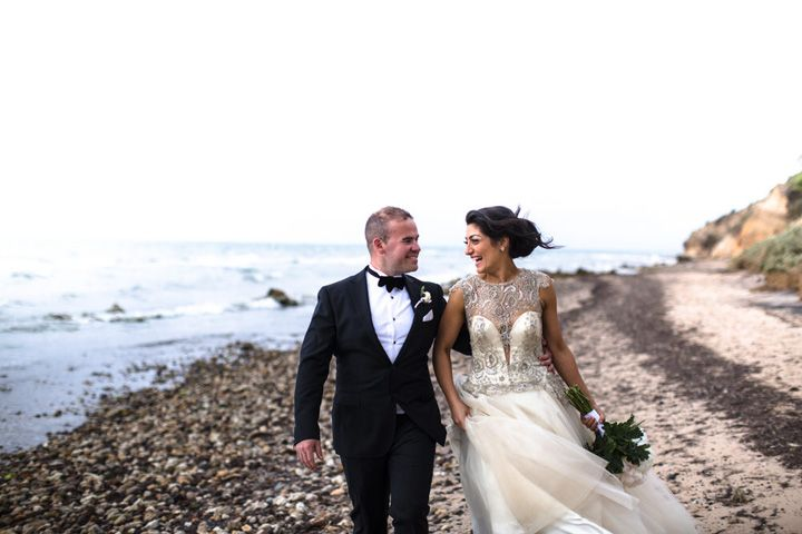 Bride and groom on the beach #weddingphotoideas