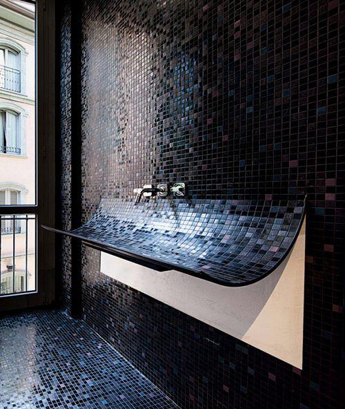 Unique Curved Bathroom Sink With Black Mosaic Tile Plus It