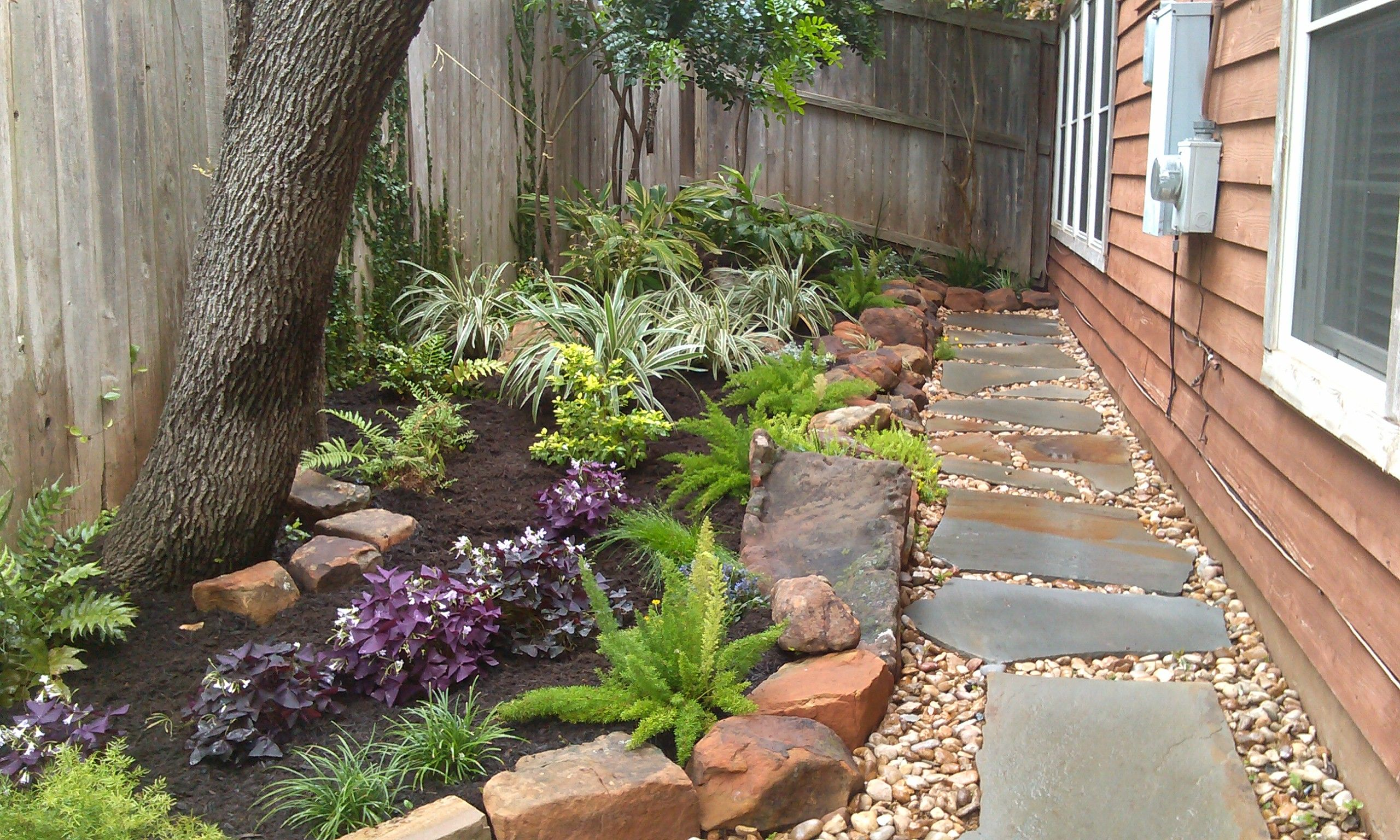 Charming Small Spaces. Natural Stone Work With Oklahoma Flagstone Set In River Rock  With Native Shade