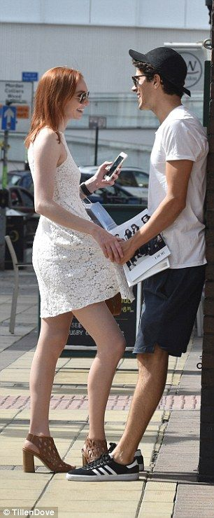 Cheeky: At one point in the shopping trip, Australian heart-throb Richardson, 24, swept Miss Tomlinson's flame-red hair back from her face before cheekily pulling her closer by her dress