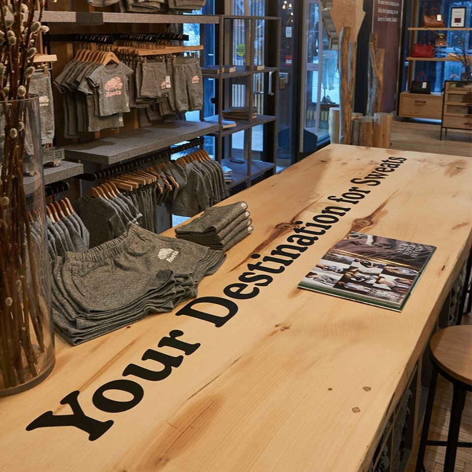 Roots6 Fb Jpg In 2020 Retail Store Interior Brand Building Retail Furniture