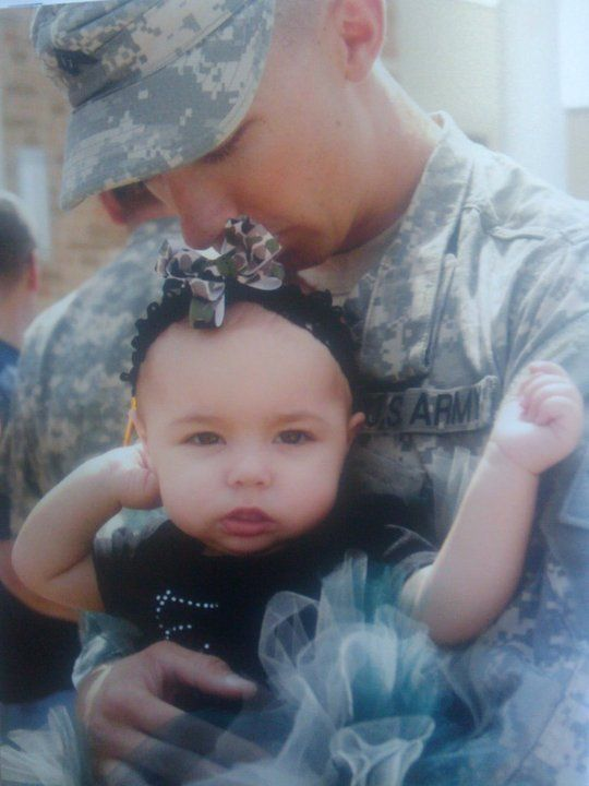 Daddy kissing his baby girl goodbye before he deploys to Afghanistan