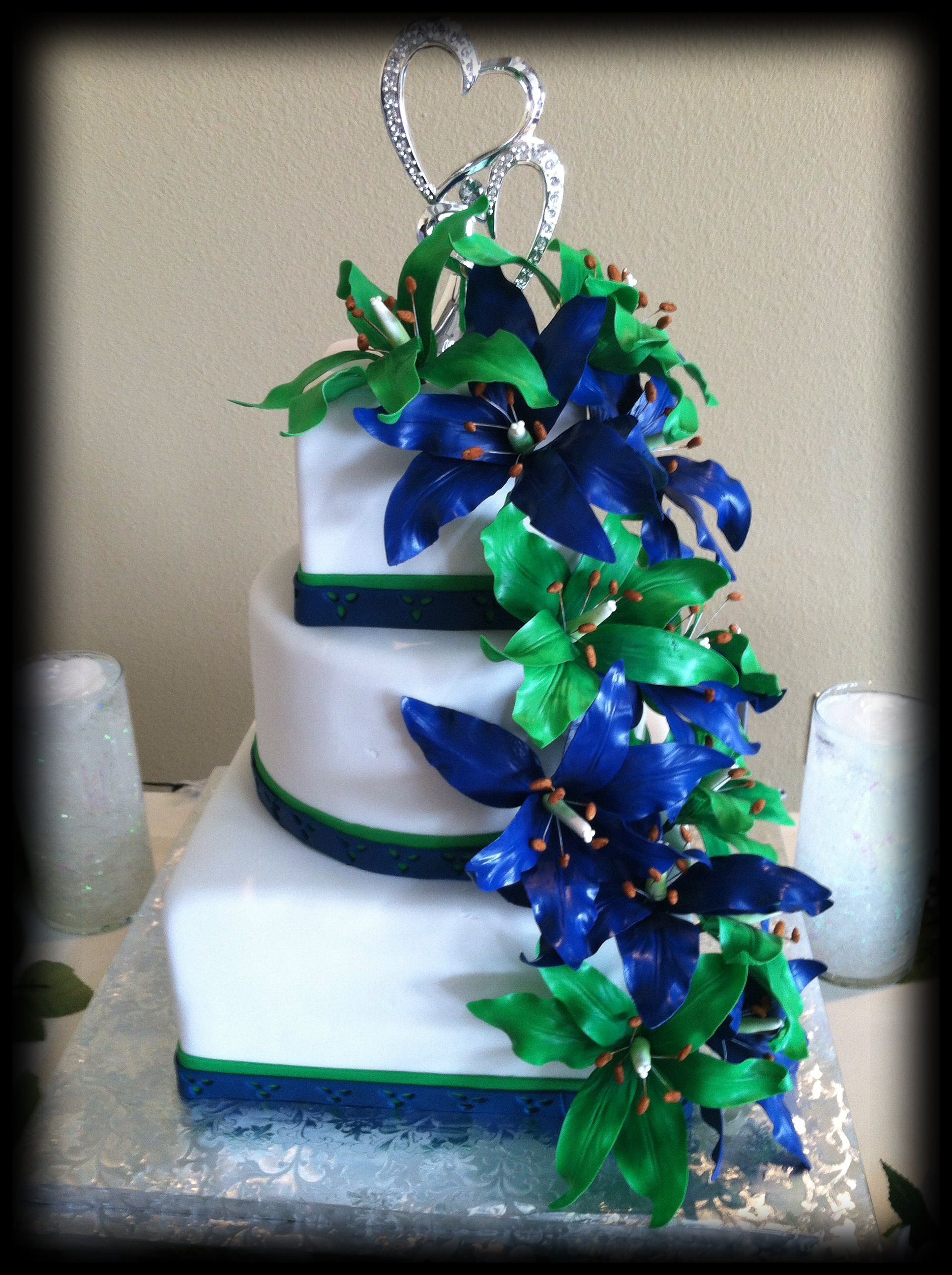 Wedding Cake With Green And Blue Sugar Lilies