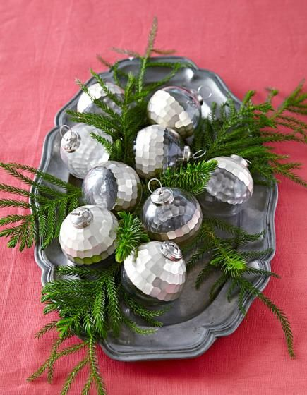 for an easy diy tablescape decorate a serving tray with silver ornaments tuck in
