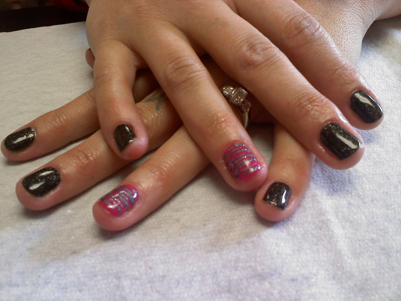 black sparkle with hot pink with silver zebra accent nail  Oasis Salon and Spa Mill Hall Pa (570)726-6565