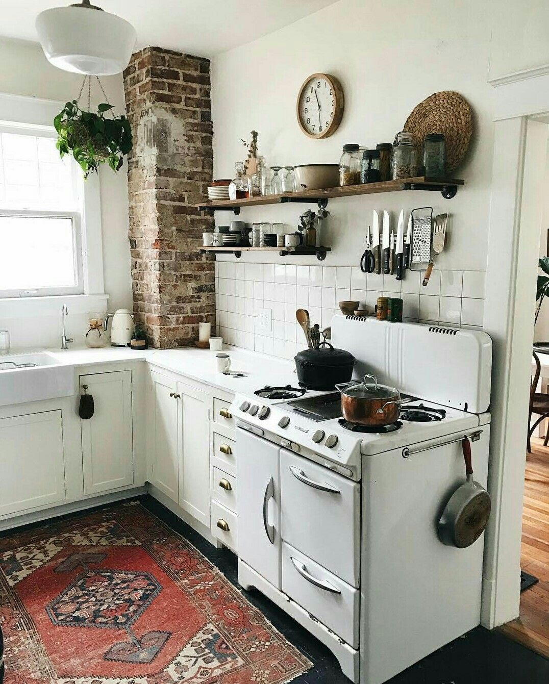 Vintage Inspired All White Kitchen With Exposed Brick And Black