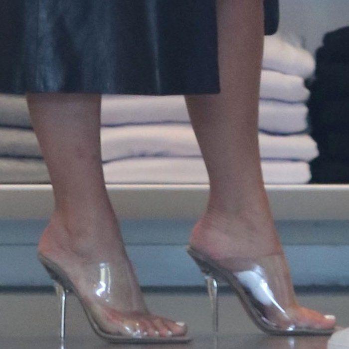 86b6c1ed9fc Kim Kardashian torturing her feet in Yeezy Season 6 PVC mules Yeezy Heels