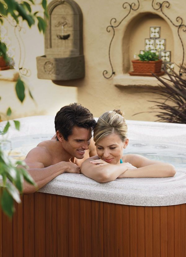 Snuggle up and whisper sweet poems in a Hot Spring hot tub. | Hot ...