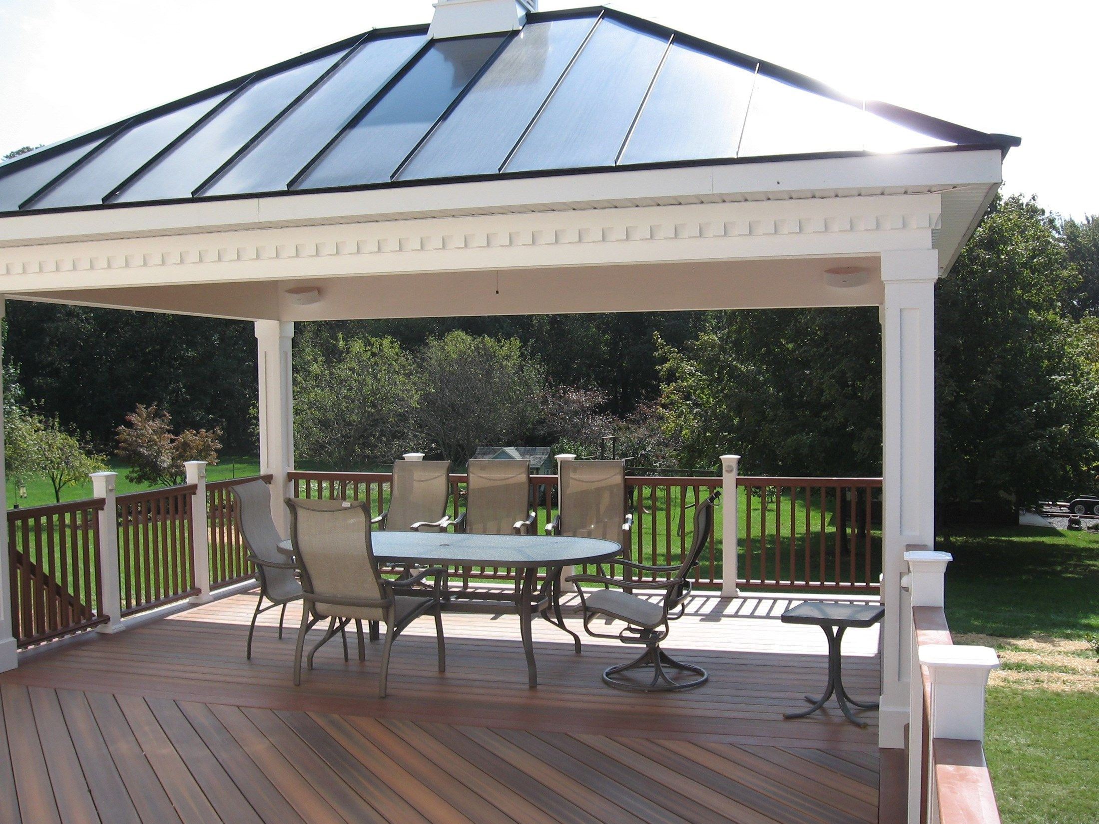 A fiberon deck and rail with a hip style roof pavilion for T g roof decking