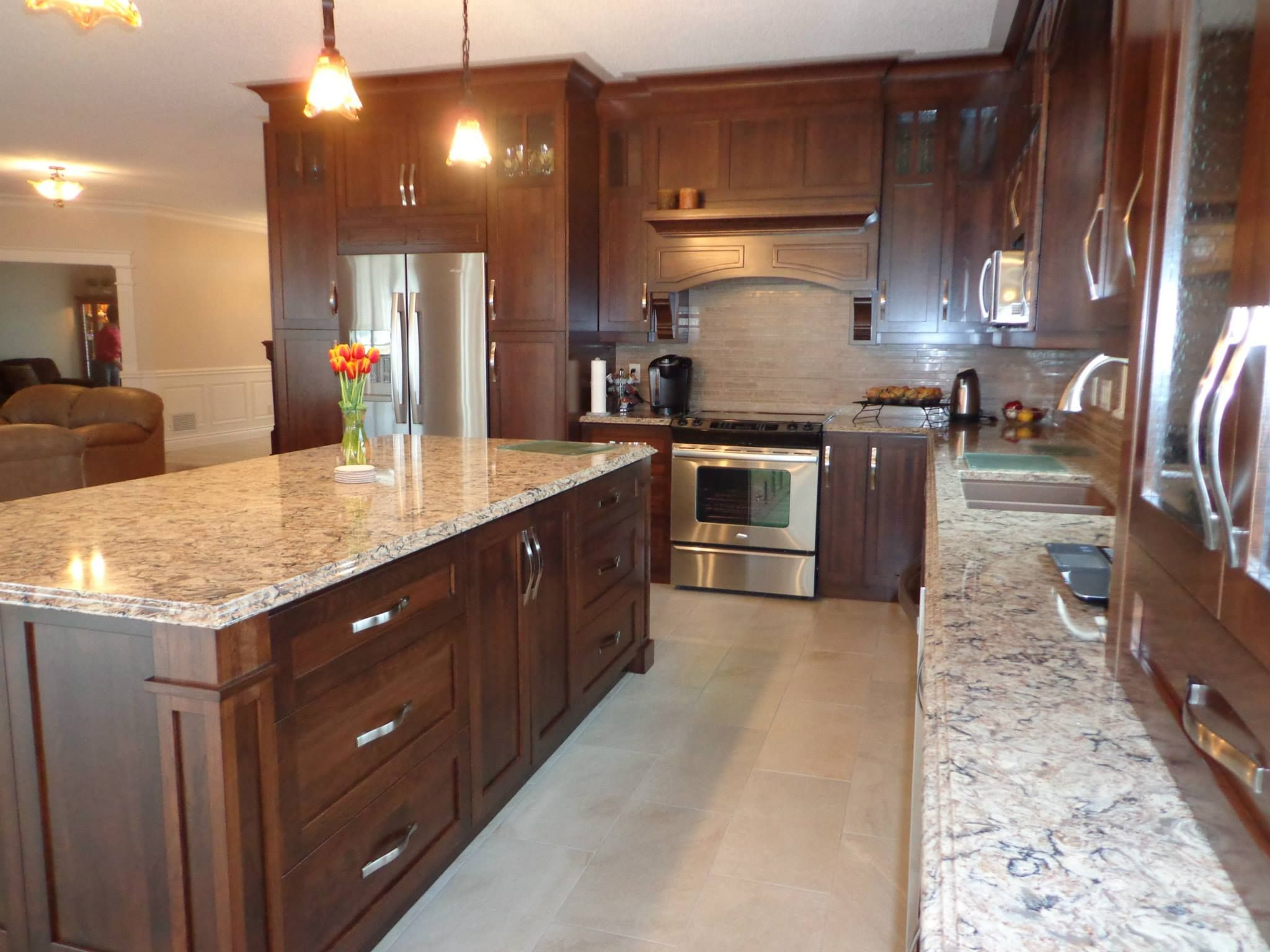 Stained cherry wood kitchen with light colored quartz