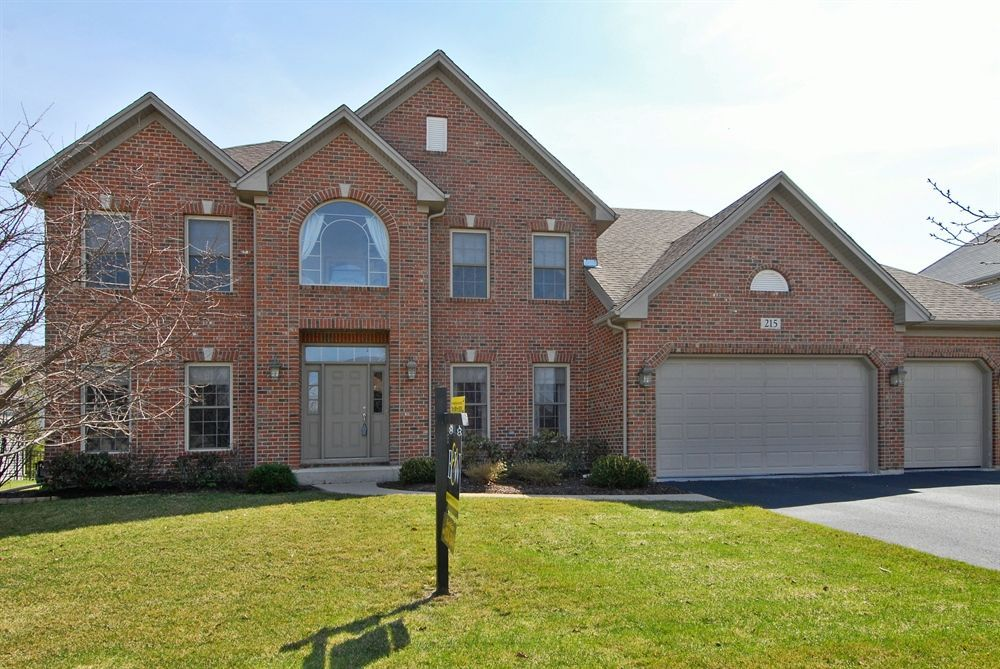 Gorgeous 4 bed/3bath/den/finished basement home listed in Oswego, Il for $339,900*Open kitchen features hrdwd flrs,granite counters,stainless steel appliances,planning desk*Vaulted family rm w/ brick fp*Deluxe mstr bdrm suite:bright sitting area,luxury bth w/whirlpool corner tub,ceramic shower,his&her WIC, ceramic tile*Finished bsmnt:can lights/wired 4 surround sound*Rear bdrms-window seats*Deck*Walk to park-n-ride/poss future train station* 215hollylane.bairdwarner.com