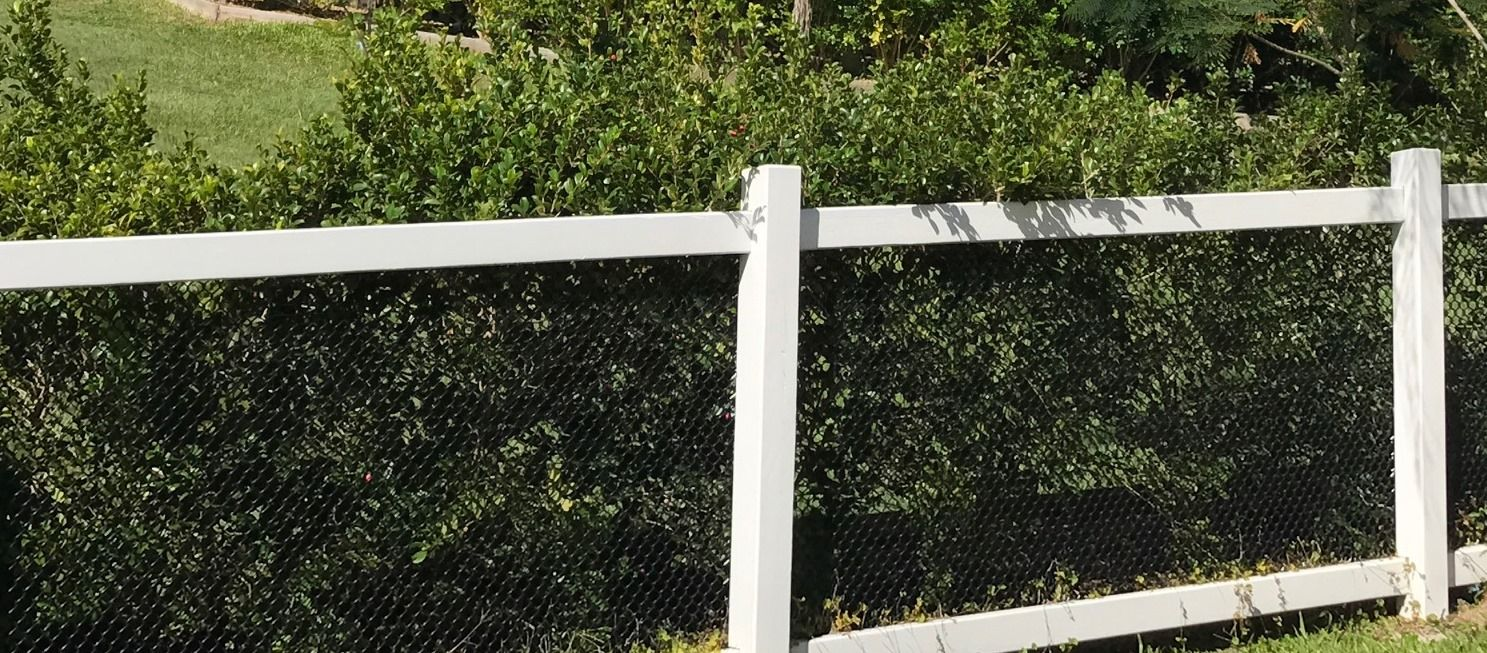 Timber fence post and rails black chain wire infill