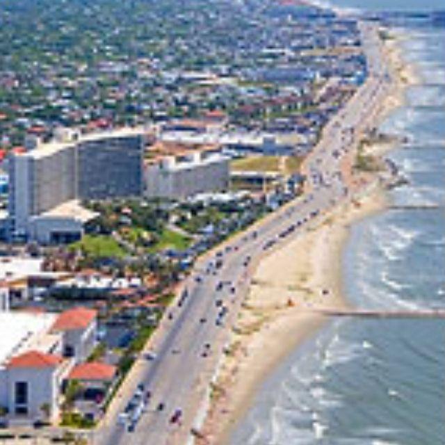 Galveston Tx: Galveston, Tx Coastline Showing Cars Driving On The Sea