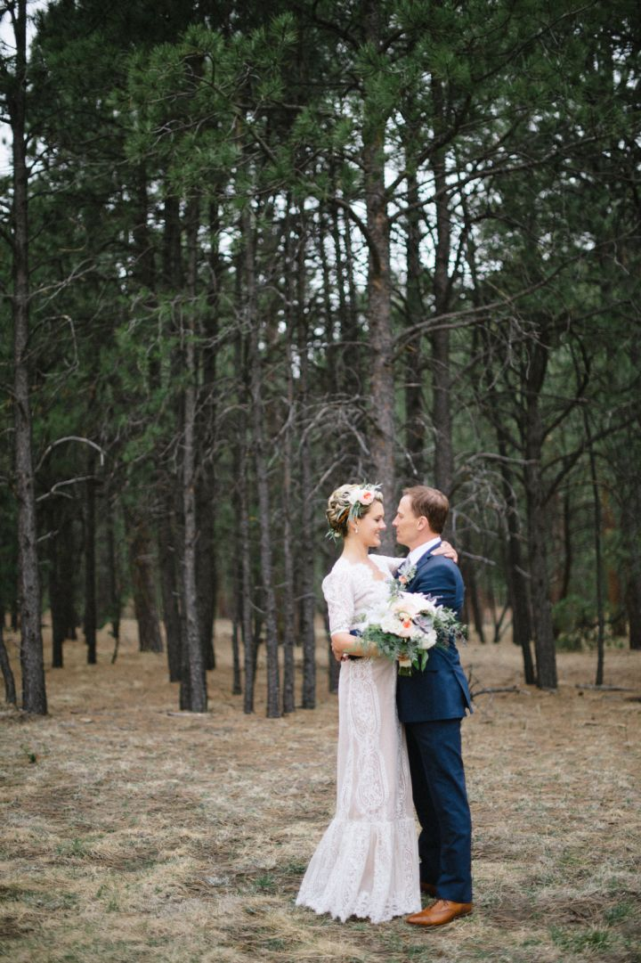 Rustic spring wedding and her lace vintage-inspired gown fulfilled with antique elements