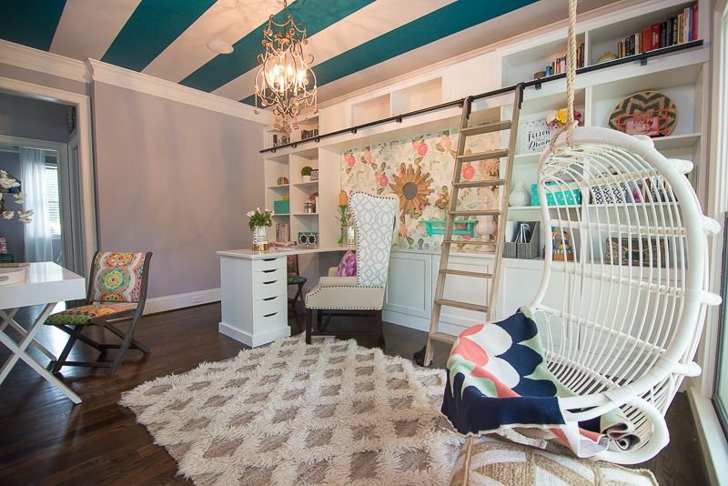 An update on our chic and colorful office renovation! Take a TOUR of our colorful home!  home-office-hanging-rattan-chair-floral-wallpaper-rolling-library-ladder-ikea-hack-bookcases-stripes-ceiling