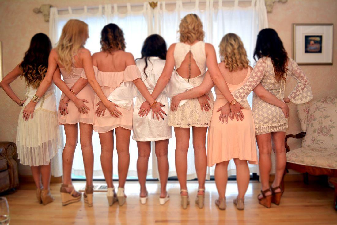 Bride and bridesmaid flashing