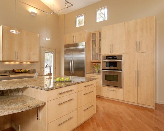 Modern Kitchen Design With Light Maple Kitchen Cabinets Track Pendant Lamps  Also Wood Palett.