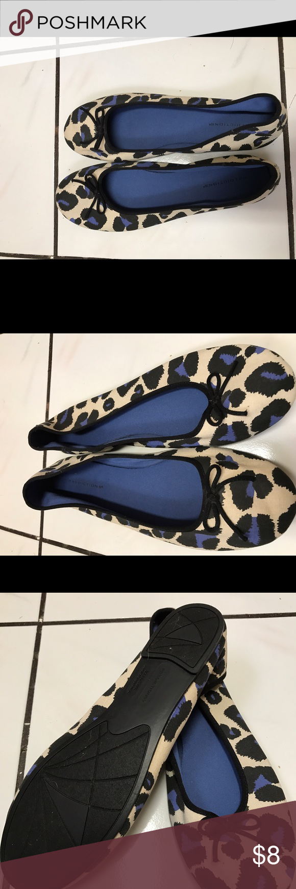 Cream color flats with blue cheetah prints Cream color flats with blue cheetah prints. Shoe has a little black bow on the toe area. Never worn, brand new. Comes from a smoke free, pet friendly home. Shoes Flats & Loafers