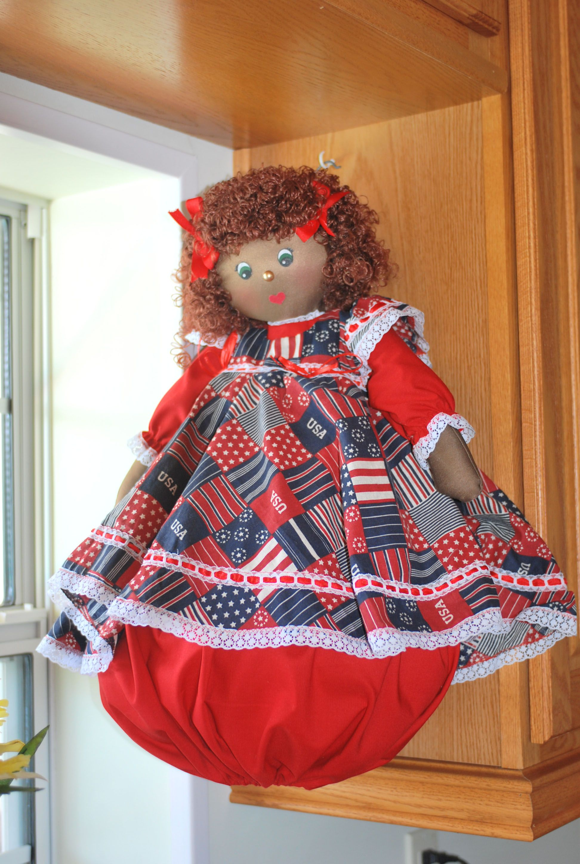 This is Hailey, she is Hand plastic bag holder doll, made in Costa Rica with great detail and materials. Her dress sports a USA theme. http://bagdollia.com/product/hailey/