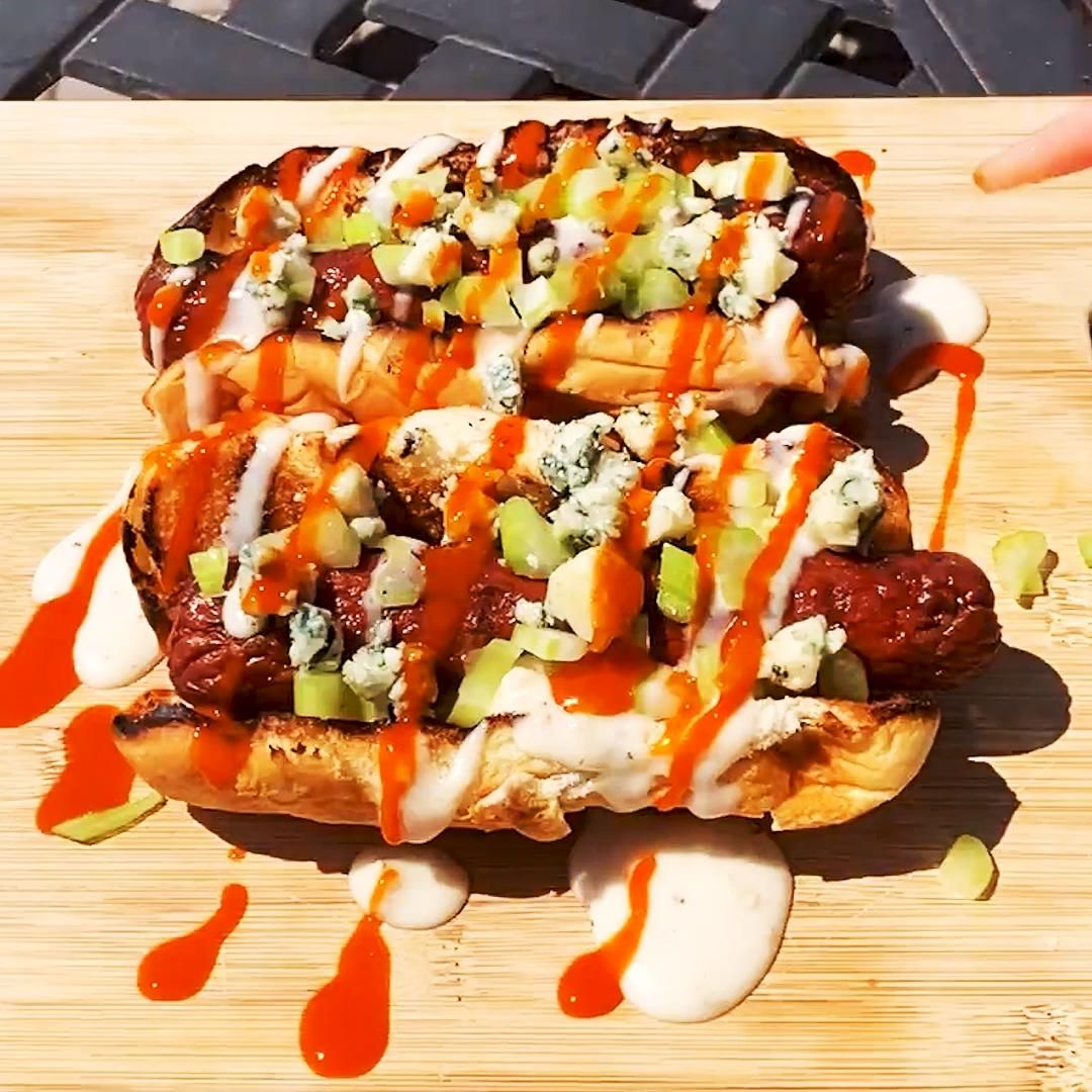 Kick your hot dog up a notch! Dress your favorite grilled hot dog they way you would your Buffalo Wings—with plenty of spicy buffalo sauce, celery, and blue cheese. Full recipe at Delish.com.