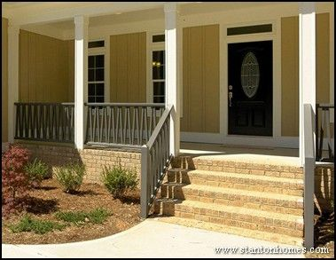 I Love The Light Yellow Vertical Siding With The White Posts And The Greyish Fence Witht He Brick Stair Front Porch Design Porch Railing Designs House Exterior