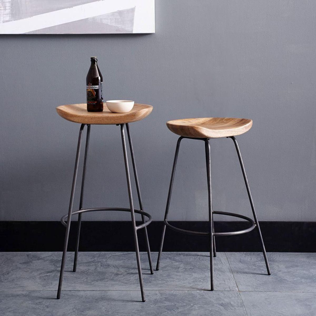 Our Alden Bar Stools Pair A Rustic Carved Wood Bucket Seat With An  Industrial Raw Steel