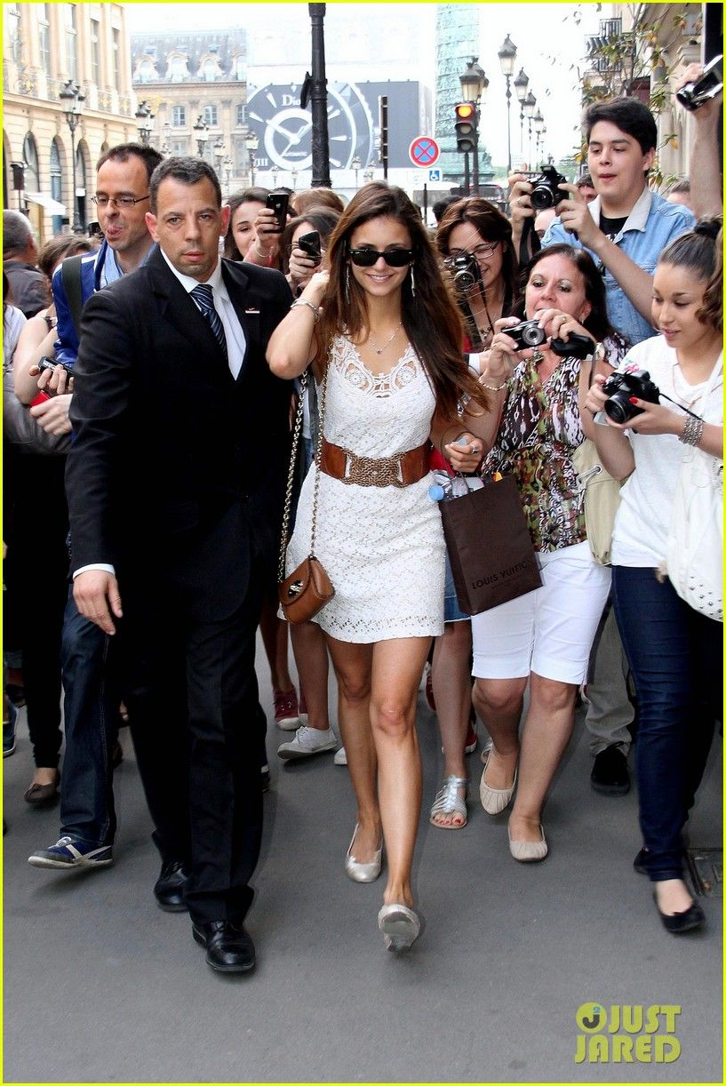 Tres chic Nina Dobrev shopping in Paris. Love the white dress and the belt that perfectly cinches the waist.