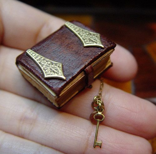 EV Miniatures Book 5 Ornate Leather Book with Brass Hinges. $29,00, via Etsy.