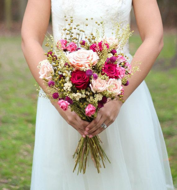 This bouquet displays a vibrant color selection of pinks, peaches ...