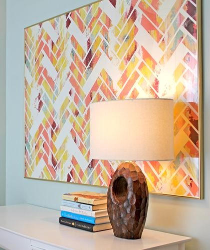 1) Paint the canvas all crazy like  2) Use painters tape to create a herringbone pattern with some missing  3) Paint over the canvas in white  4) Remove tape and voila!