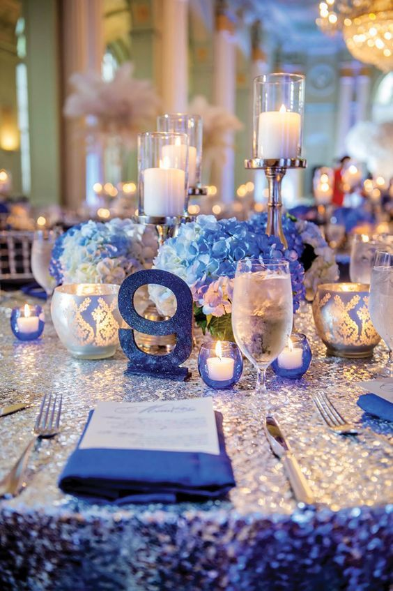 Surrounded By Family Friends And Heavenly Platinum And Blue Wedding Decor The Jacks Blue Wedding Centerpieces Blue Wedding Decorations Silver Winter Wedding