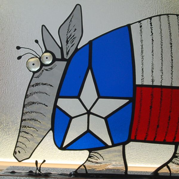 Close up of Texas Armadillo Stained glass details are black Reusche stain mixed with clove oil and applied with a quill pen measures 8.5 inches x 13 inches in the base he measures 10 inches x 15 inches