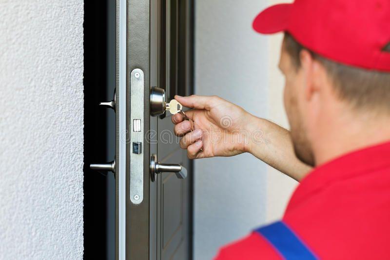 Door lock service - locksmith working. In red uniform , #SPONSORED,  #service, #lock, #Door, #locksmith… in 2020   Commercial locksmith, Mobile  locksmith, Locksmith services