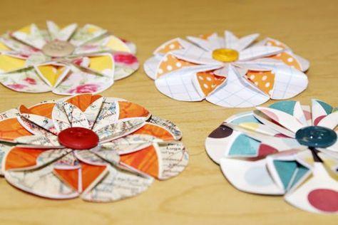 Então faça esta flor de papel e botões aos