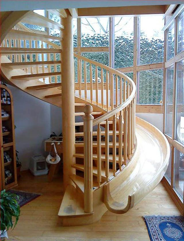 Wooden Spiral Staircase With Slide Beside It (3)