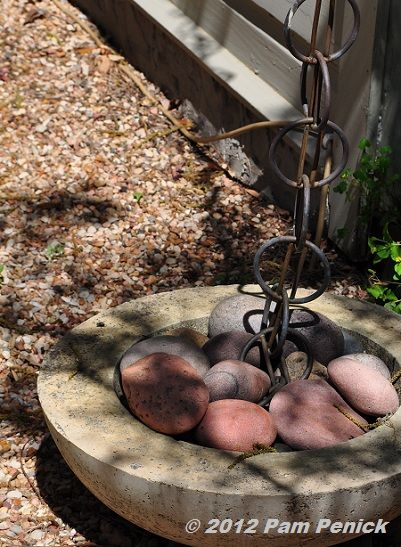 At The Corner Of The House A Concrete Dish Filled With River Rock Accepts Runoff From The Roof Directe Modern Fire Pit Fire Pit Lighting Rectangular Fire Pit