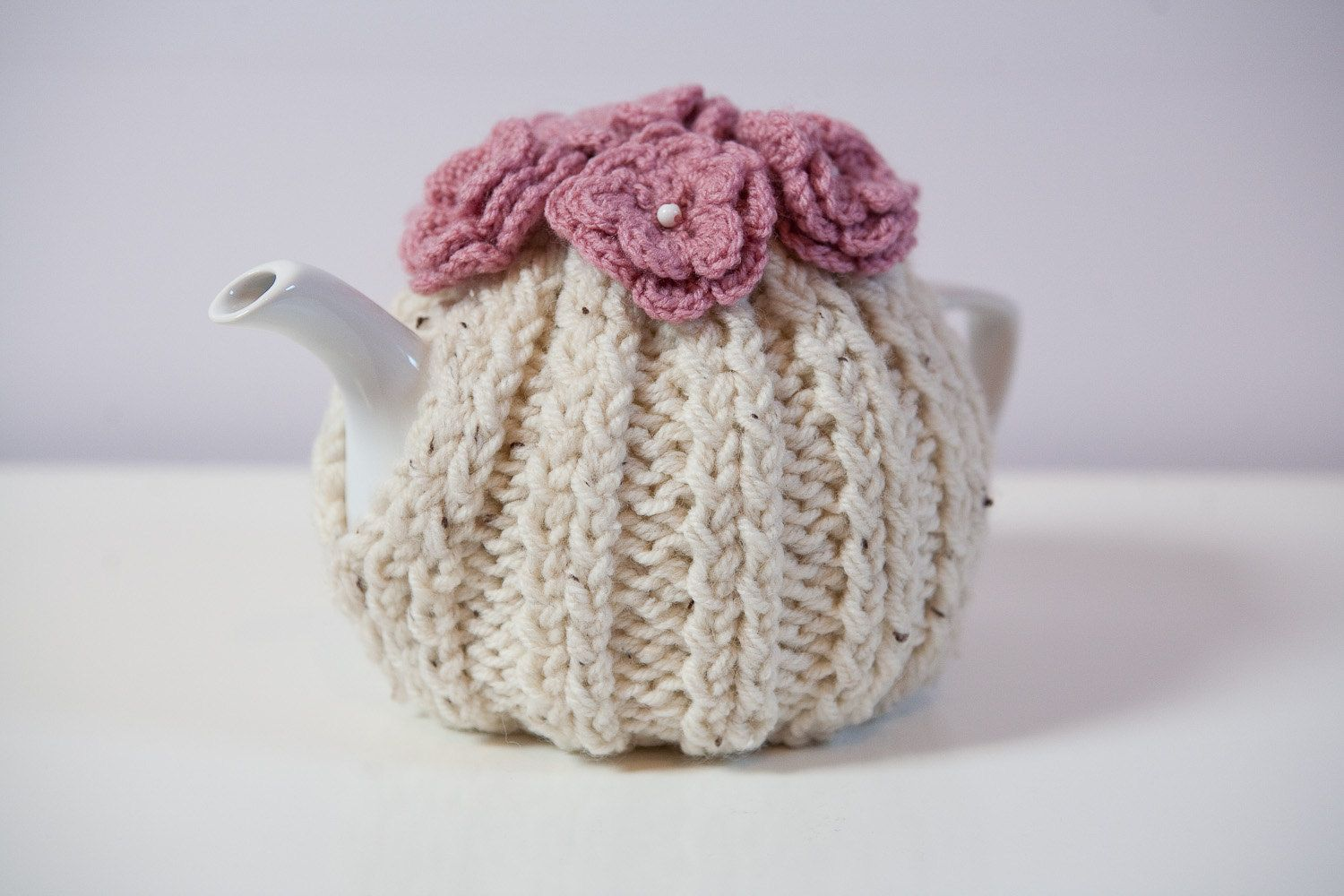 Hand Knitted Tea Cosy Patterns : Cream coloured hand knitted tea cosy with crocheted flowers on top teapot c...